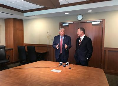 Missouri Gov. Mike Parson, left, and Mayor Brian Treece discuss priorities for Columbia