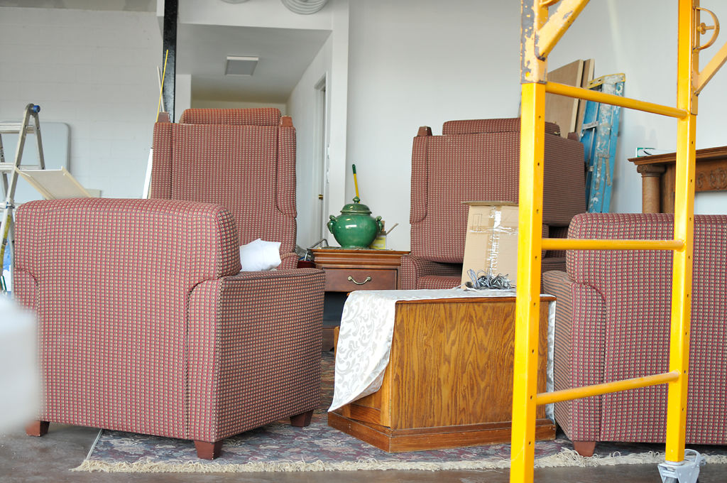 Several armchairs are stacked on top of each other Tuesday at the new Love Coffee