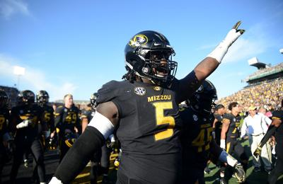 Terry Beckner, Jr. points to the fans as the team exits the field at halftime (copy)