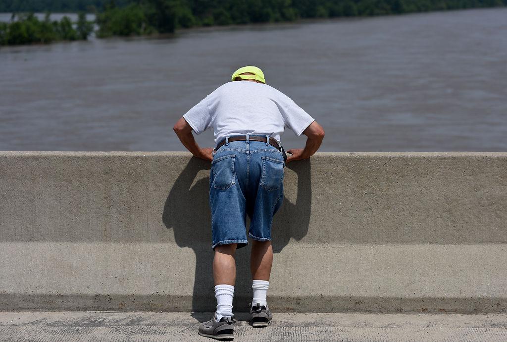 John Wilke peers over the bridge that extends across the Missouri River