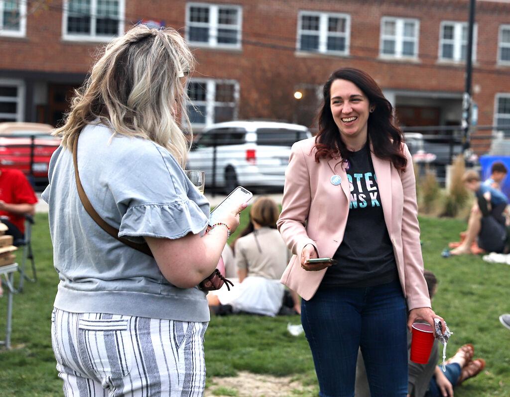 Katherine Sasser talks with her friend