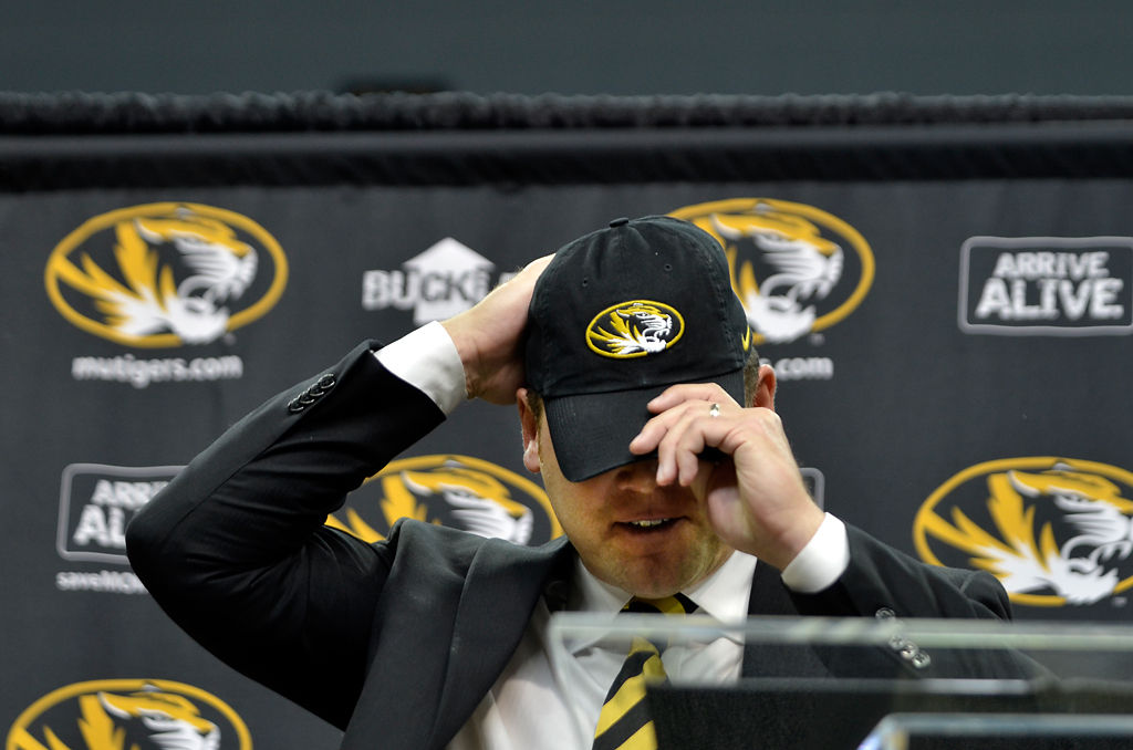 Barry Odom adjusts his hat
