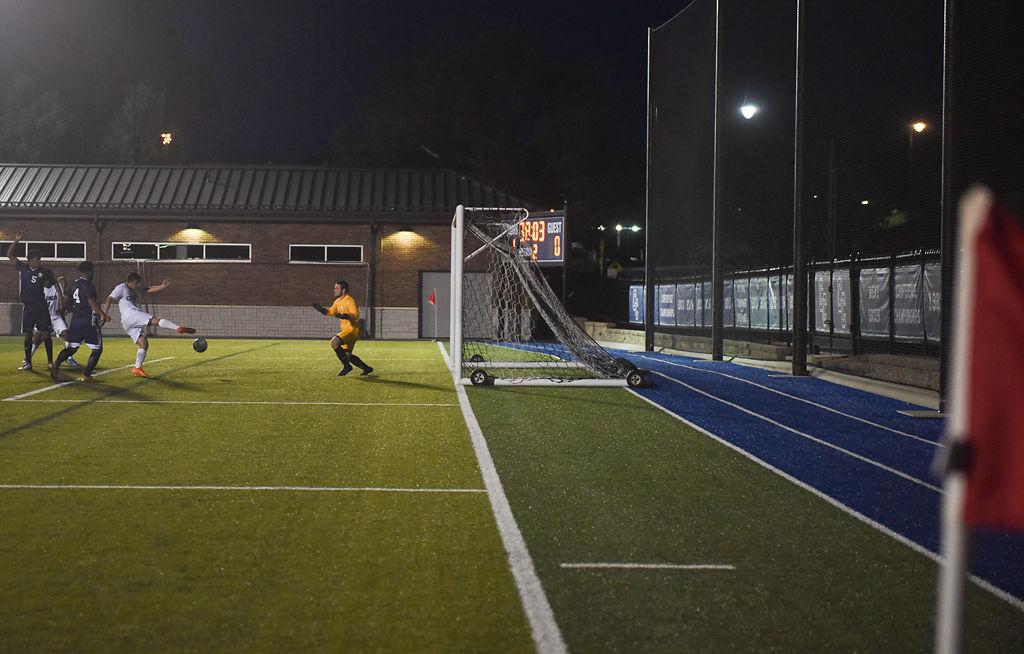 Juan Pablo Agredo scores against the Judson University goalkeeper