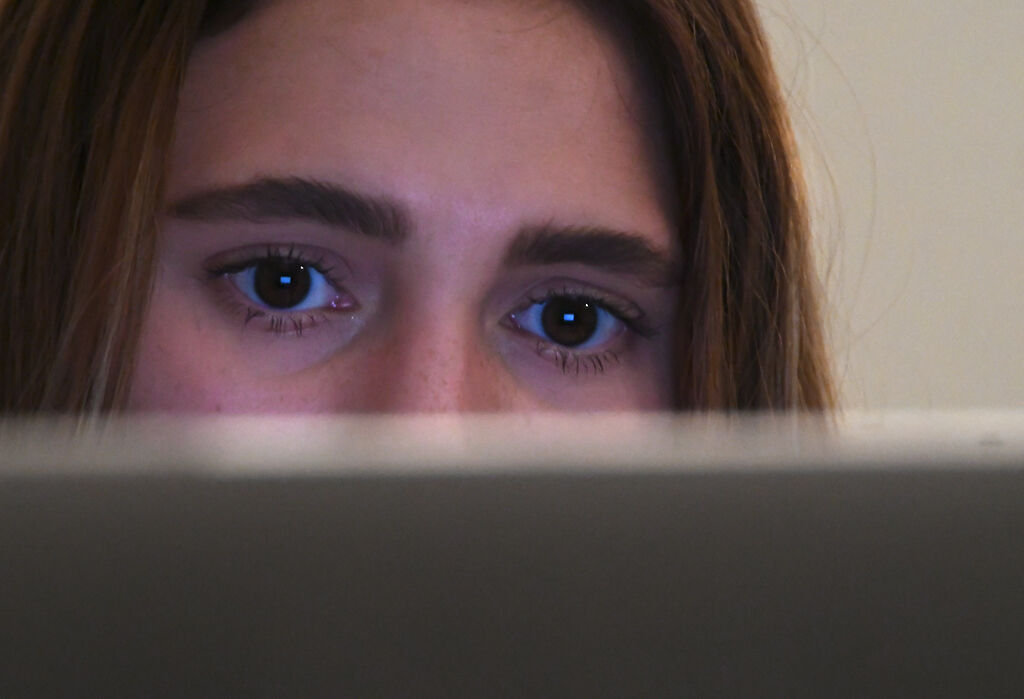 MU student Mira Sachdev looks at her screen on Wednesday at The Grind Coffee House.