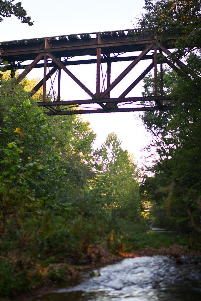 Haw Creek flows under an abandoned railroad bridge