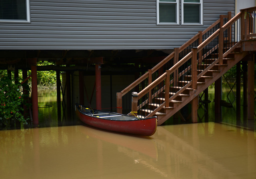 A canoe floats at the base of a staircase