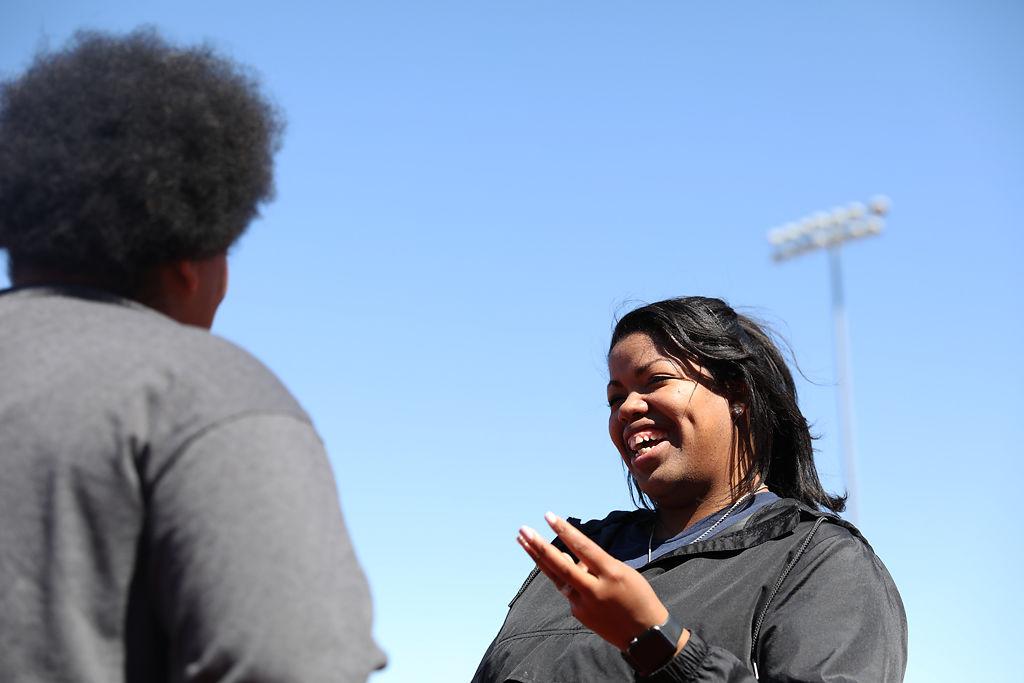 Ashanti Williams, right, head volleyball coach at Battle High School, talks with senior Paris Williams