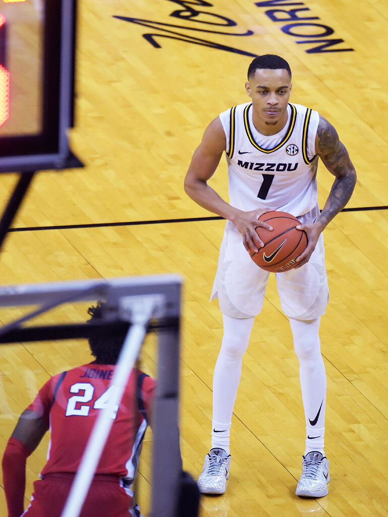 Missouri guard Xavier Pinson looks to make a play against Ole Miss Rebels