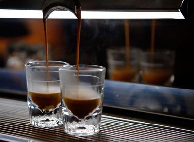 Espresso drips into shot glasses