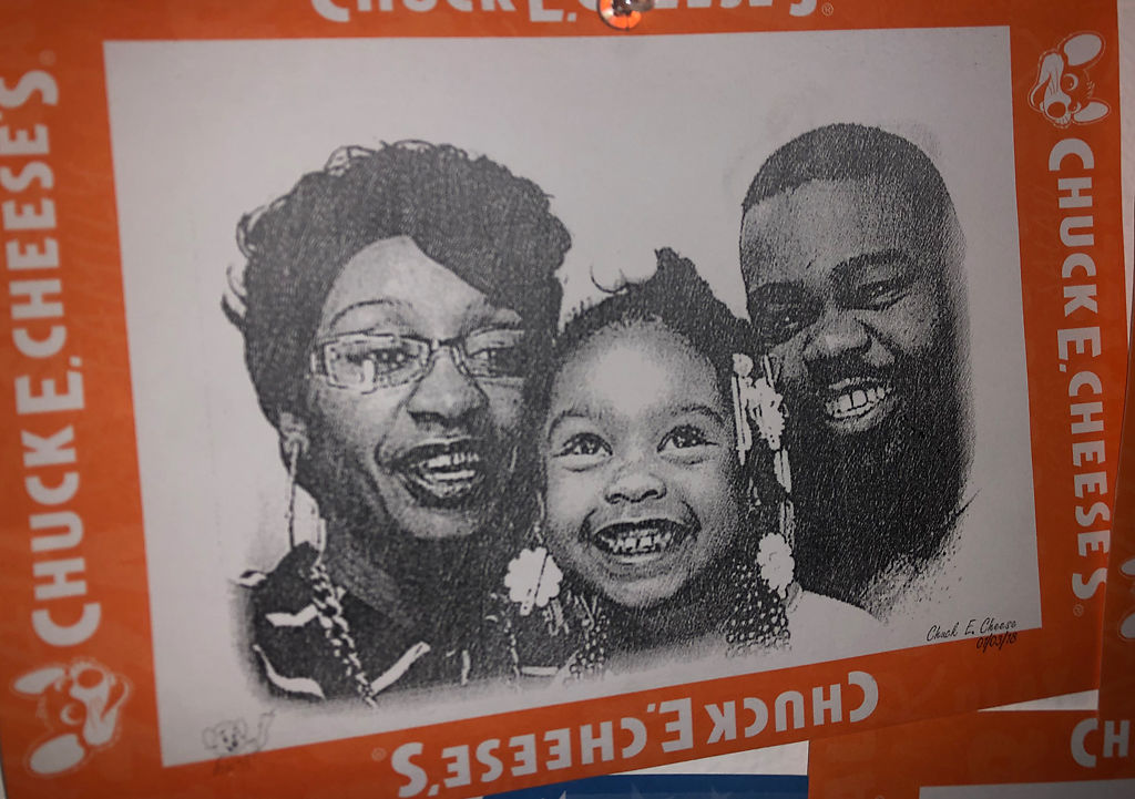 A picture of Houston and Hargrove, with their daughter, Chunk hangs on her wall