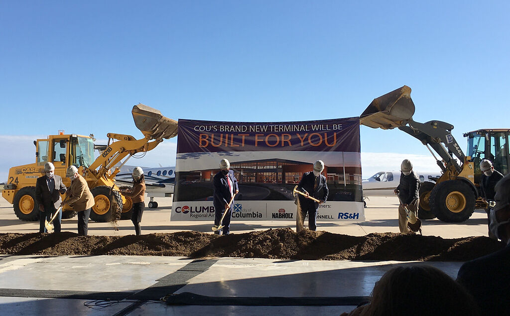 Local and state officials shovel ceremonial dirt