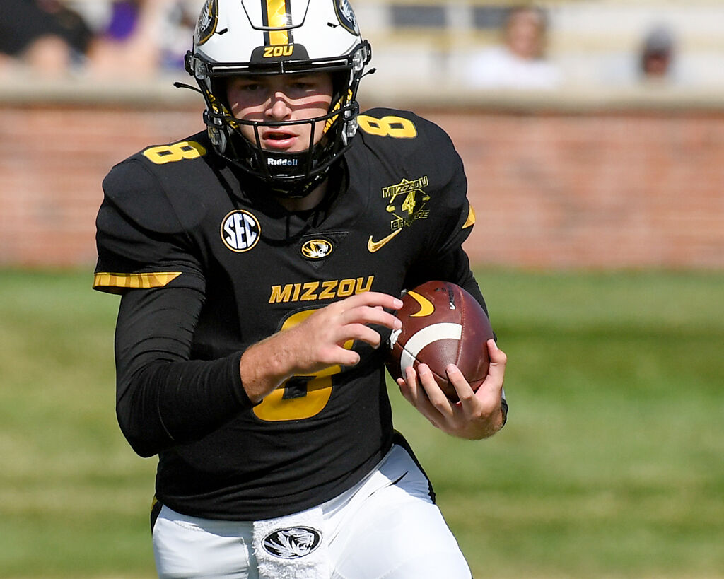 Connor Bazelak scrambles with the ball (copy)