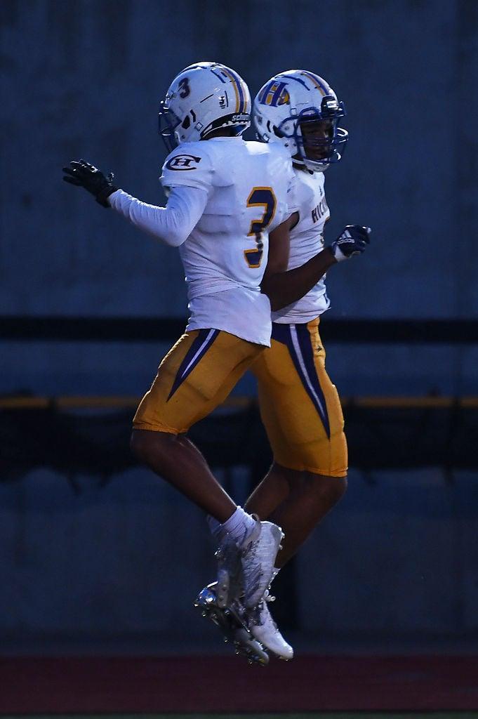 Devin Turner celebrates with TJ Turner after TJ scored a touchdown