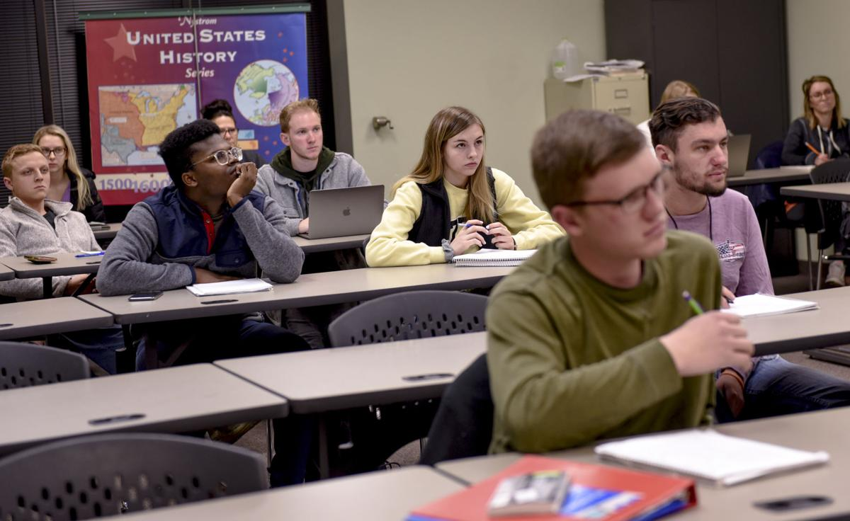 MACC students listen to their professor during class Monday