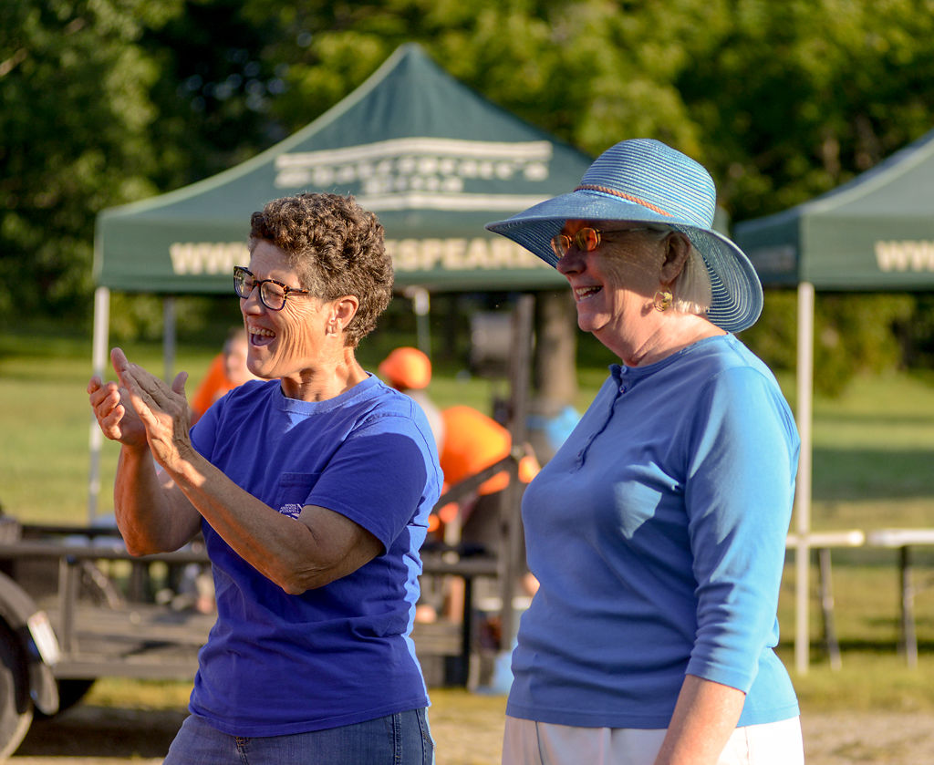 Janet Thompson, left, and Betsy Peters cheer