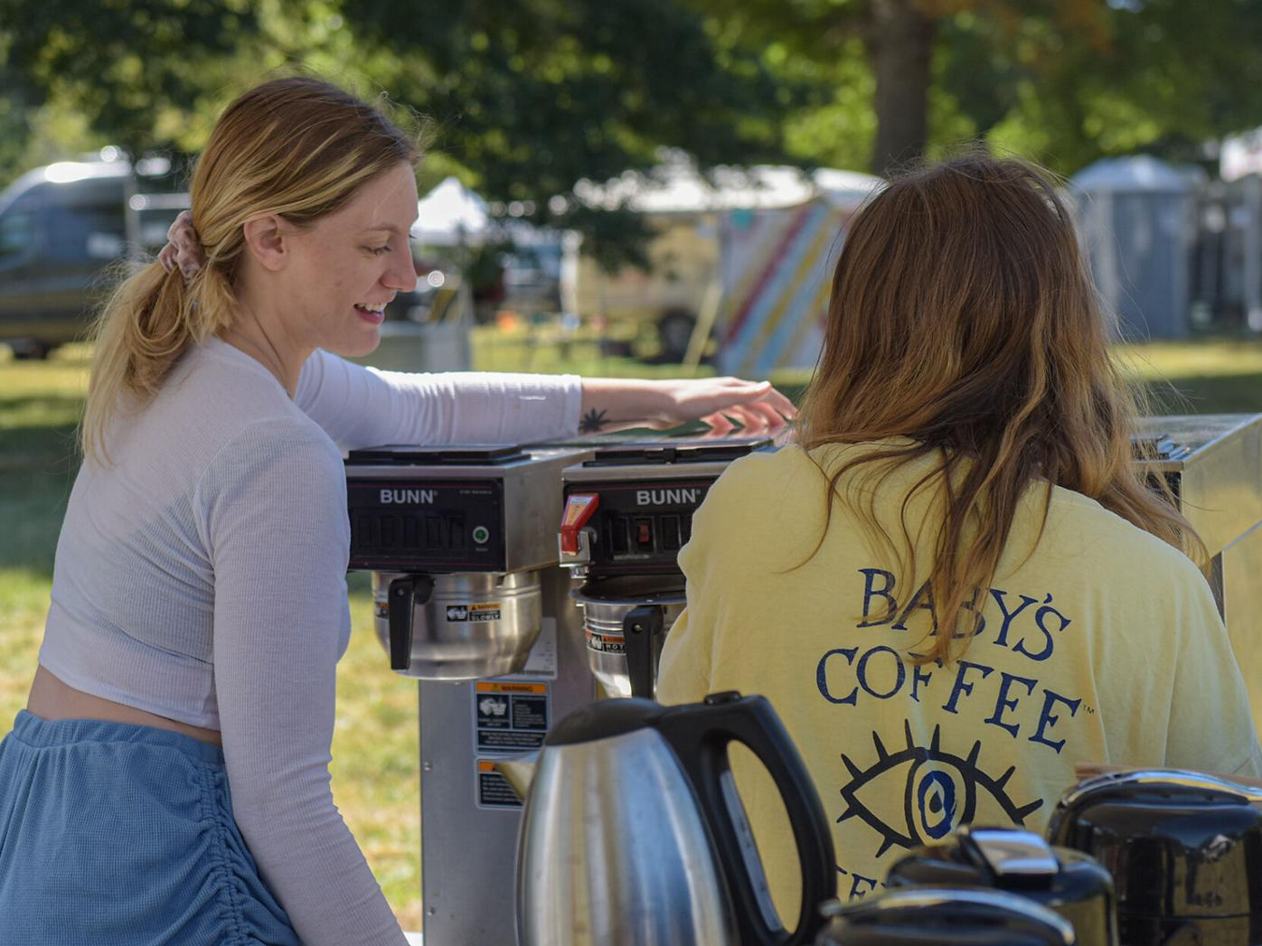 Delaney Fenton, left, and Angela Bandoni  set up the Lakota Coffee stall for the Roots N Blues Festival