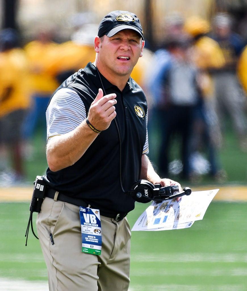 Missouri head coach Barry Odom motions to a referee