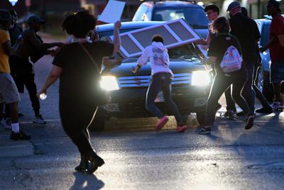 A car hit a protester at the intersection of Broadway and Providence on Monday evening in Columbia. (copy)