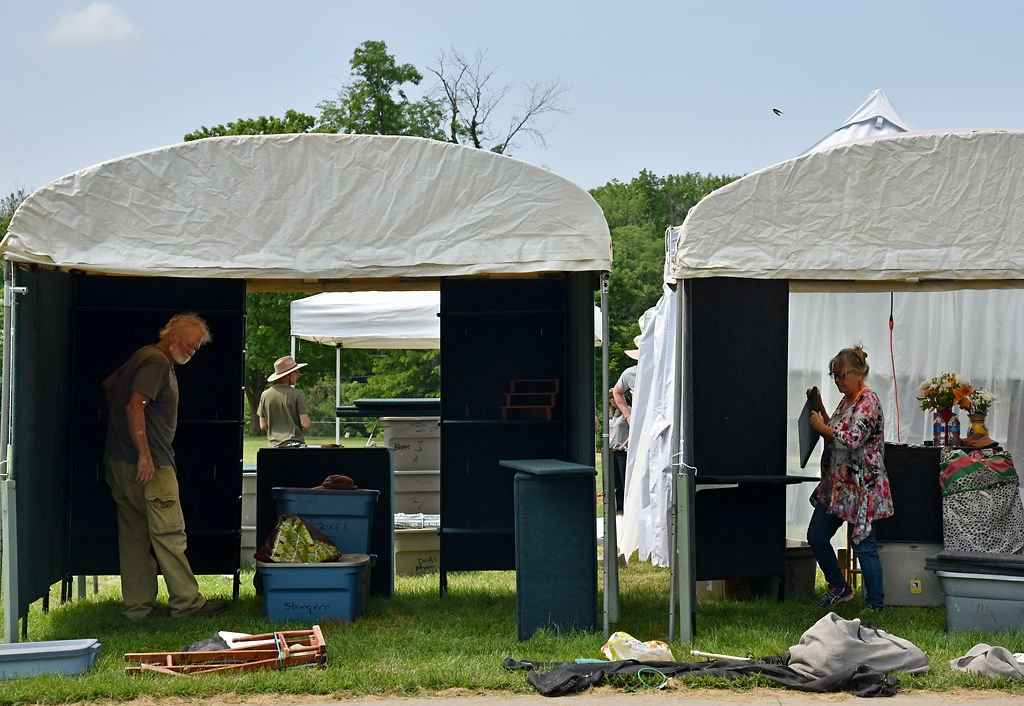 Douglas Flascock and Marianne Hanson set up their tents to display their work