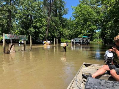 Surging water levels at Cooper's Landing postponed clean up efforts