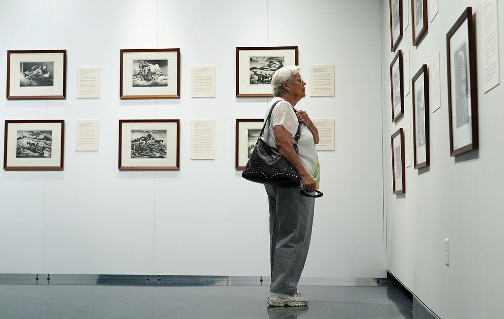 Carmen Moore looks at artwork at the new Thomas Hart Benton exhibit