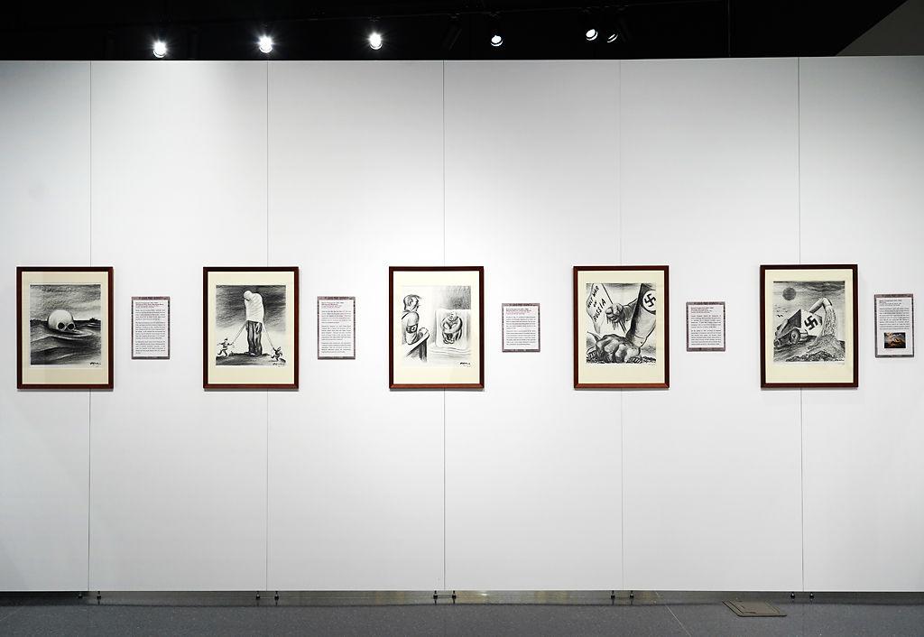 Artwork is displayed at the Thomas Hart Benton Exhibit