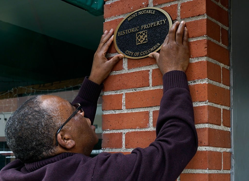 Ed Tibbs shows the spot where he plans to place the new historical property plaque