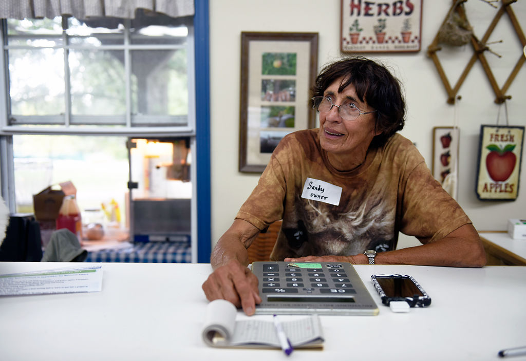Sandy Binder sits at the store-front counter