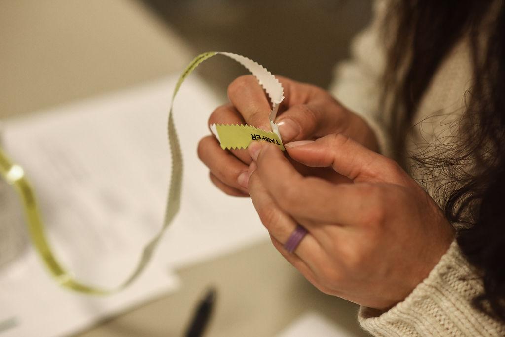 An ER nurse pulls off a piece of evidence tape