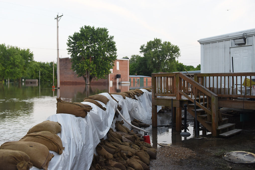 Concrete walls with sandbags on both sides were built to protect Mokane