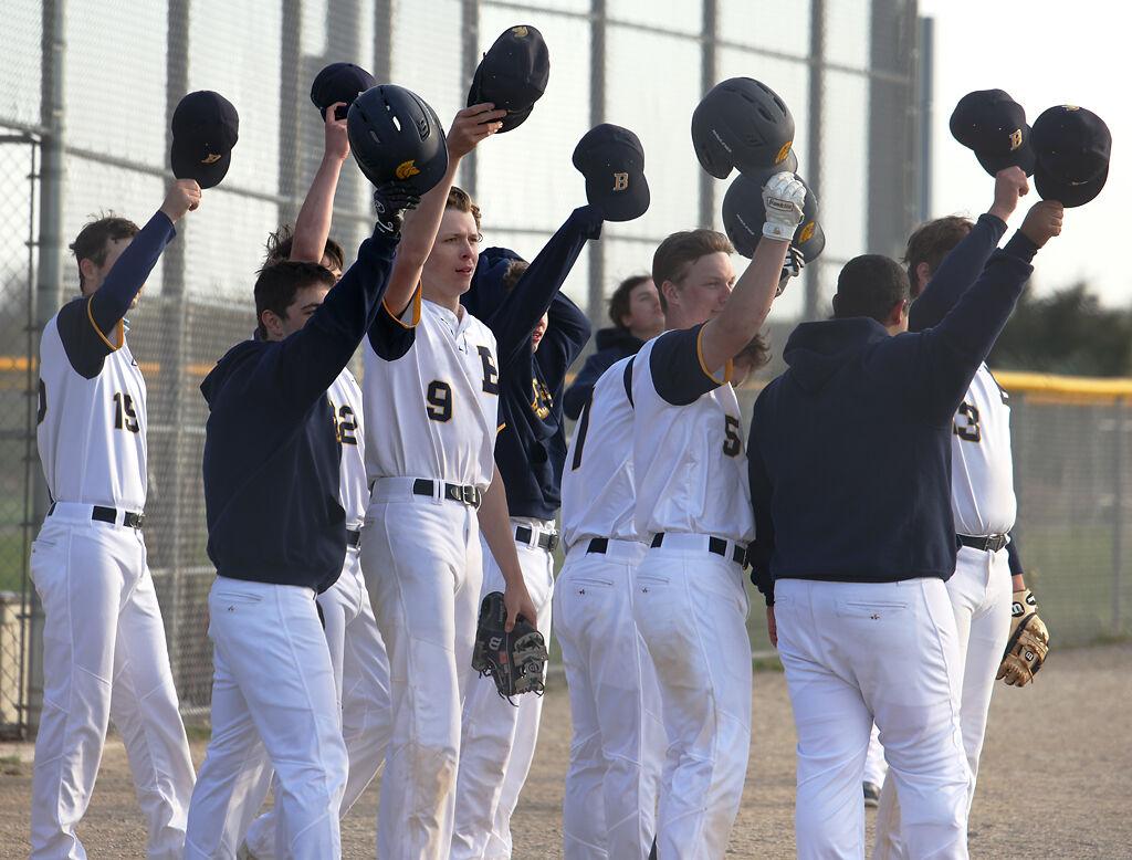 Battle High School's baseball team waves their helmets