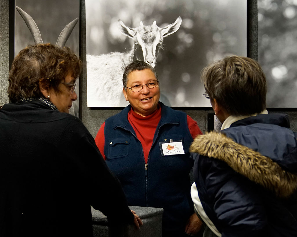 Kim Carr talks with customers about her work