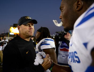 Barry Odom talks with Memphis players on Oct. 20