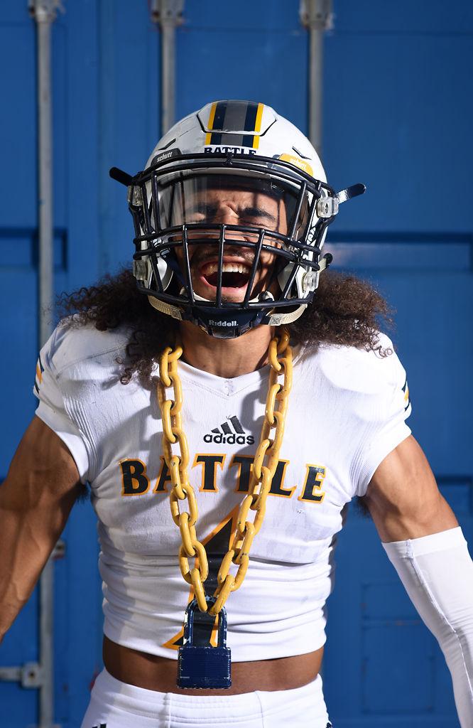 Battle High School senior defensive back Trevonne Hicks yells