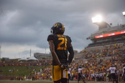 Missouri DB Christian Holmes bows to the crowd on Sept. 21