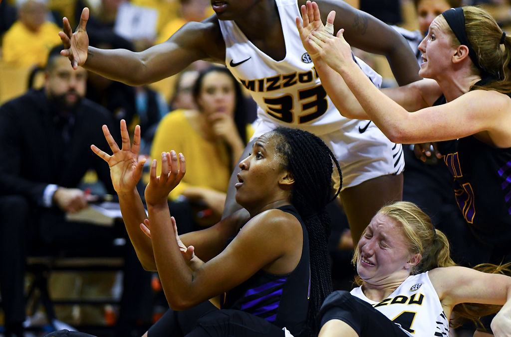 From left, clockwise, Northern Iowa's Bre Gunnels, Missouri's Aisha Blackwelland Jordan Chavis and Northern Iowa's Kristina Cavey scrap for the ball