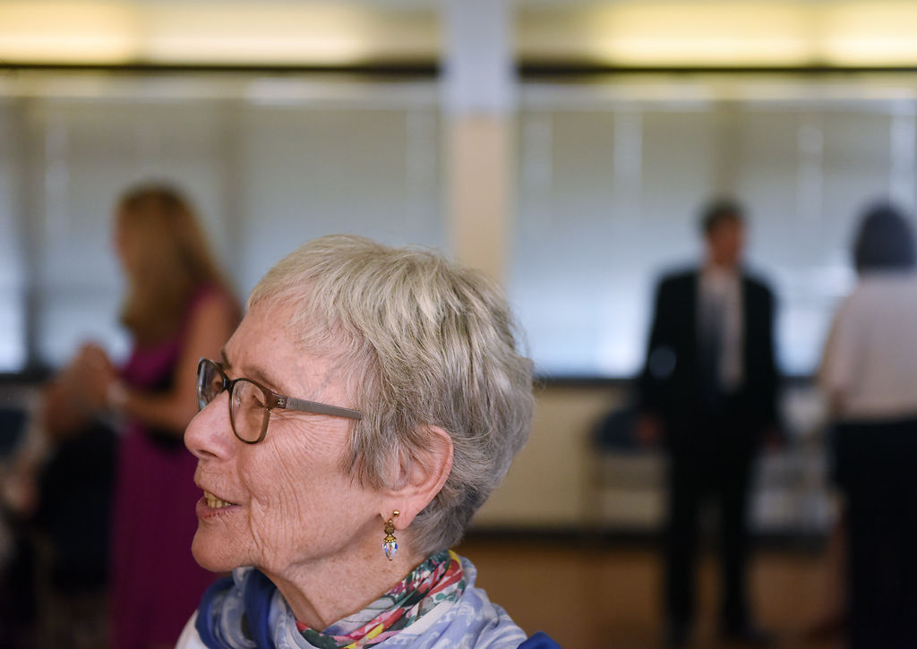 Axie Hindman, the wife of former mayor Darwin Hindman, greets attendees