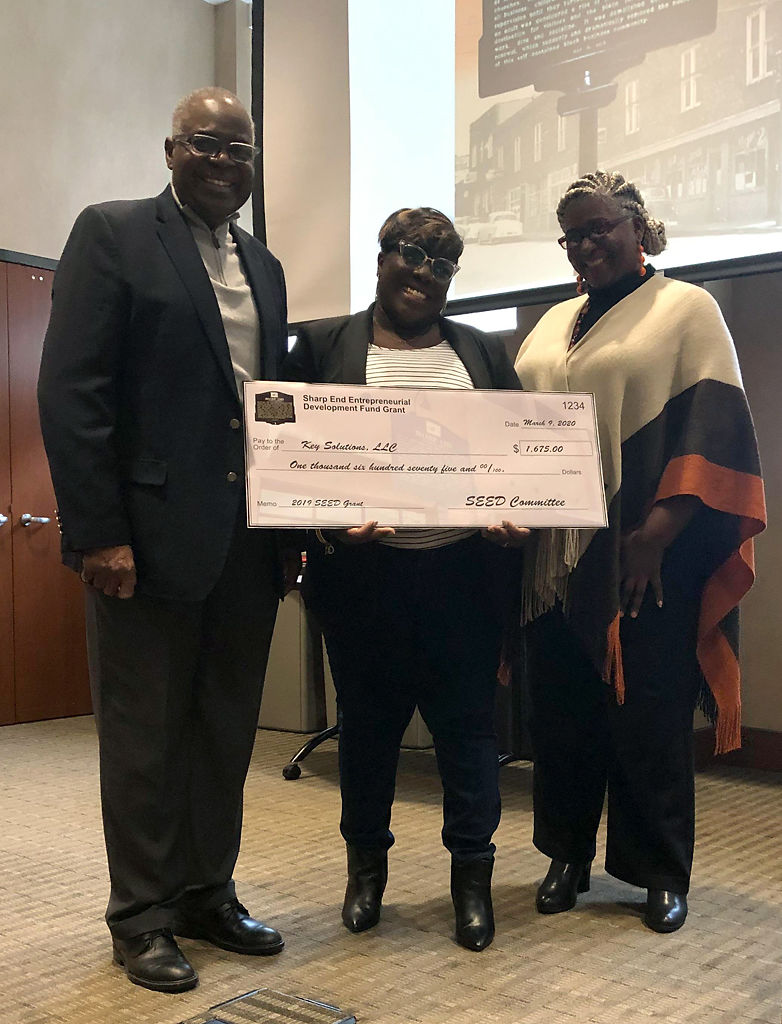 Jim Whitt founder of the SEED Fund, Karita Moss of Key Solutions, Shannon Wilson-Robinson of the SEED Fund pose for a picture on Monday