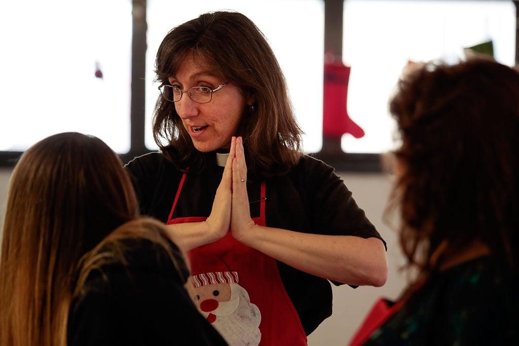 Cathy Rosenholtz demonstrates praying hands