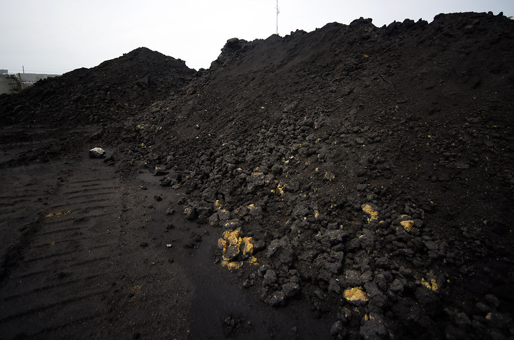 The effects of the years of coal burning at the Columbia Municipal Power Plant can be seen in the mounds of coal ash