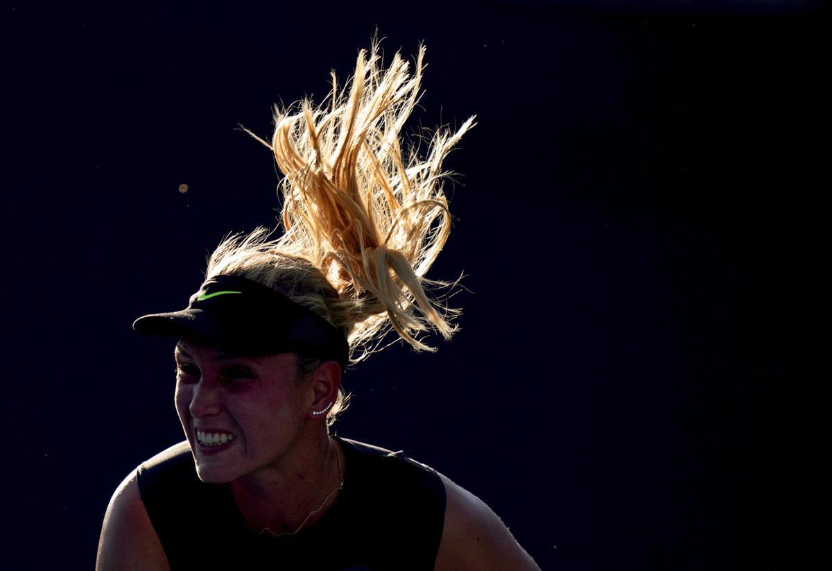 Donna Vekic, of Croatia, serves to Kaia Kanepi,
