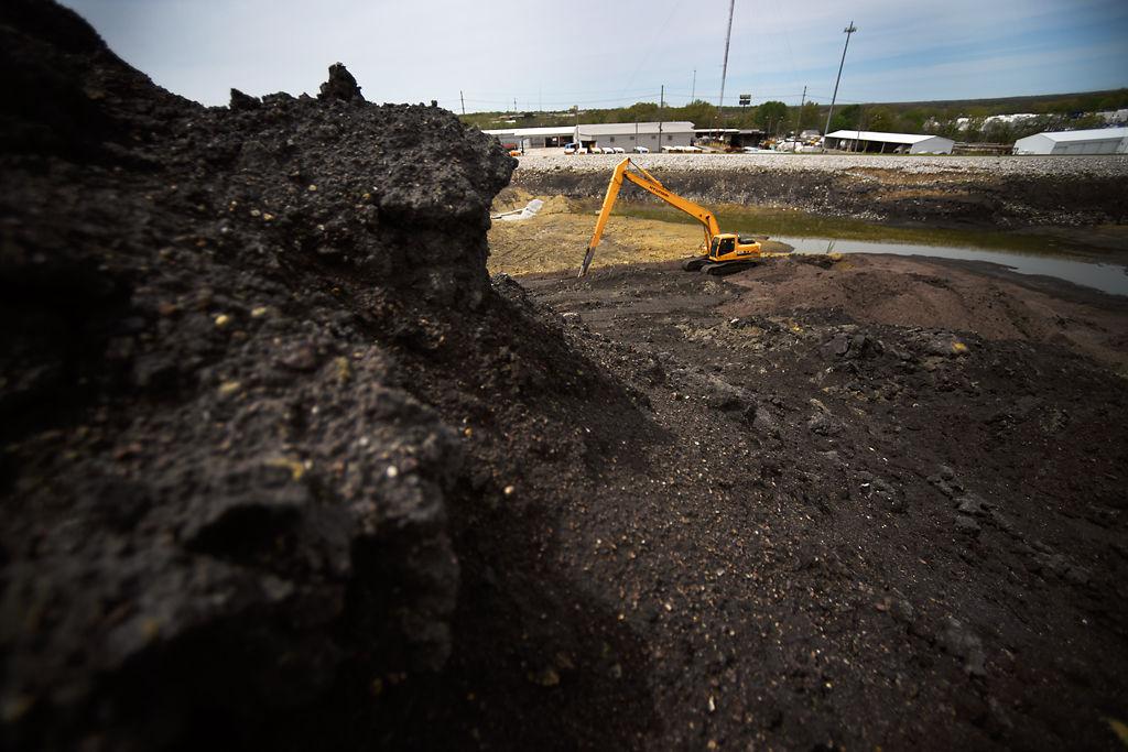 More's Lake sits hidden behind mounds of coal ash