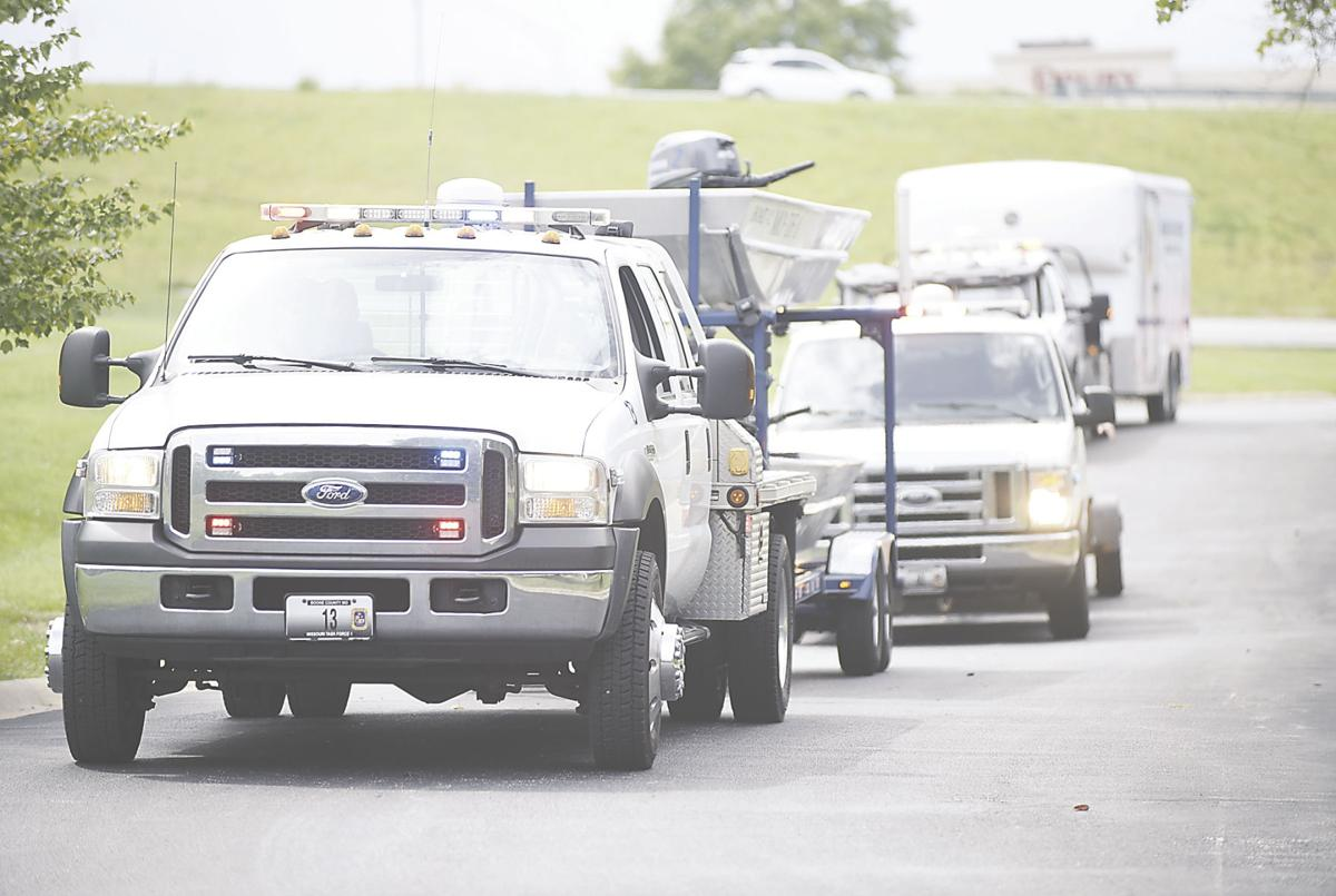 Trucks Hauling Missouri Task Force 1 drive up to the Boone County Fire Department Headquarters