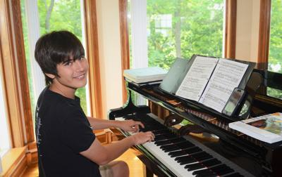 Anthony Wu practices the piano
