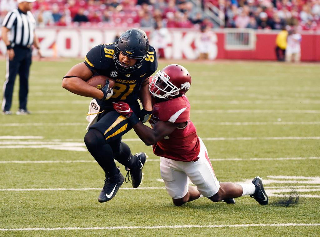 Missouri tight end Albert Okwuegbunam is tackled