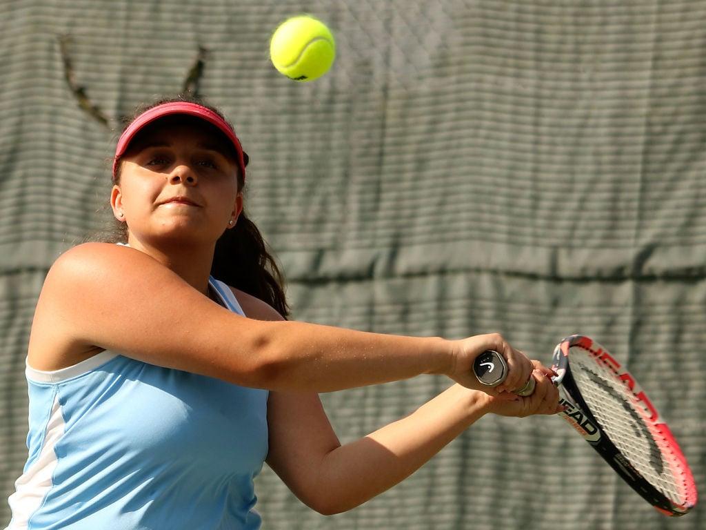 Christa Howard draws back to return a serve