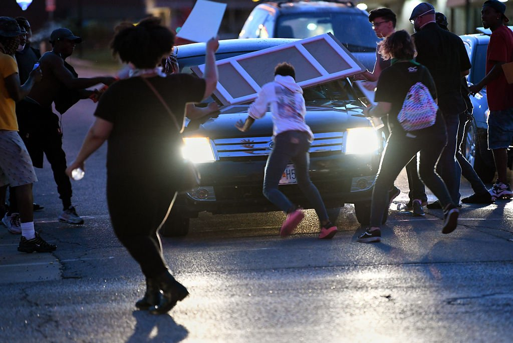 A car hit a protester at the intersection of Broadway and Providence on Monday evening in Columbia.