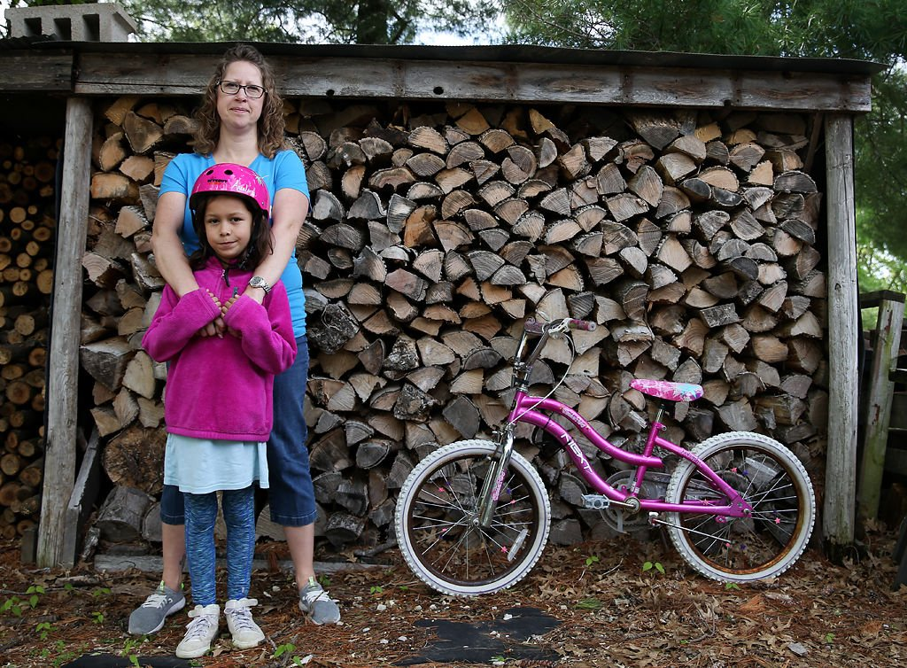 Kim Arcelona and her daughter Naomi, 8, live within sight of the Labadie Energy Station