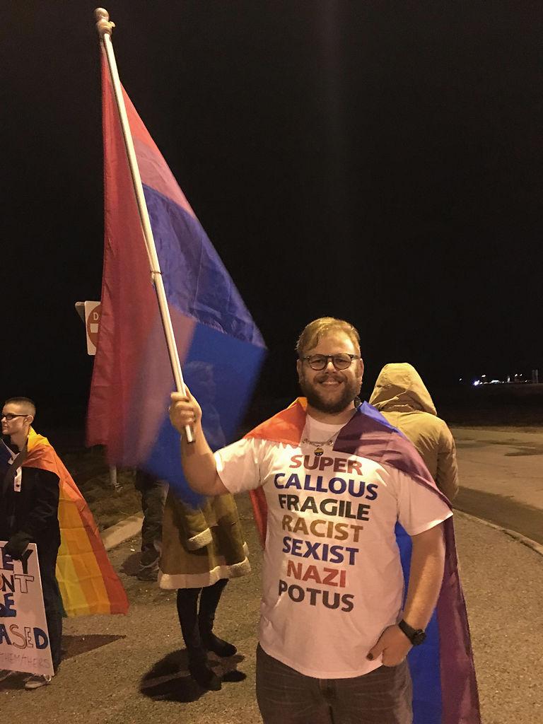 Nick Hudson carries a bisexual pride flag