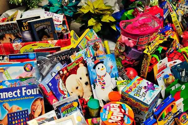 Donated Toys Sit Under A Christmas Tree Photos
